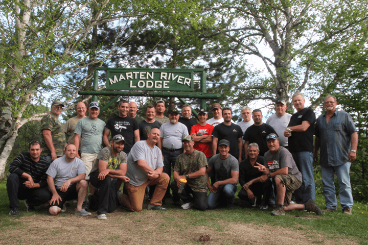 corporate group under sign of marten river lodge